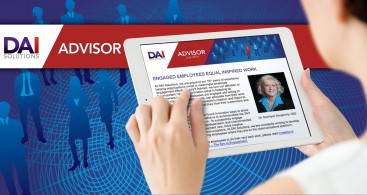 Photo of a tablet with DAI Solutions newsletter displayed
