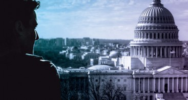 Photo of the U.S. Capitol building with a contemplative person silhouetted in front.