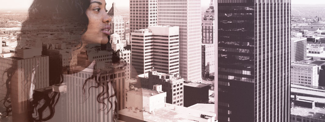 Photo of city buildings with a contemplative business woman superimposed on top.